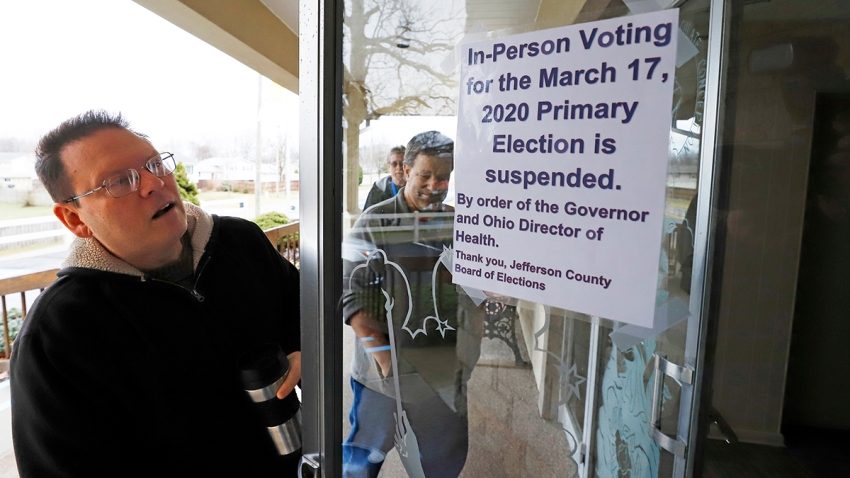 Jefferson County Elections officials arrive to pack up the polling place at Our Lady of Lourdes church in Wintersville, Ohio, March 17, 2020. Ohio's presidential primary was postponed amid coronavirus concerns.