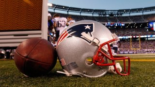 In this Aug. 29, 2012, file photo, a New England Patriots helmet sits on the sideline next to a football during the first half of a preseason NFL football game between the New York Giants and the New England Patriots in East Rutherford, N.J.