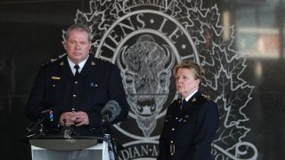 Royal Canadian Mounted Police (RCMP) Chief Supt. Chris Leather (left) and RCMP commanding officer Lee Bergman deliver a news conference in the wake of a deadly shooting rampage near the town of Portapique that left at least 16 people dead, April 19, 2020, at RCMP headquarters in Dartmouth, Nova Scotia, Canada.