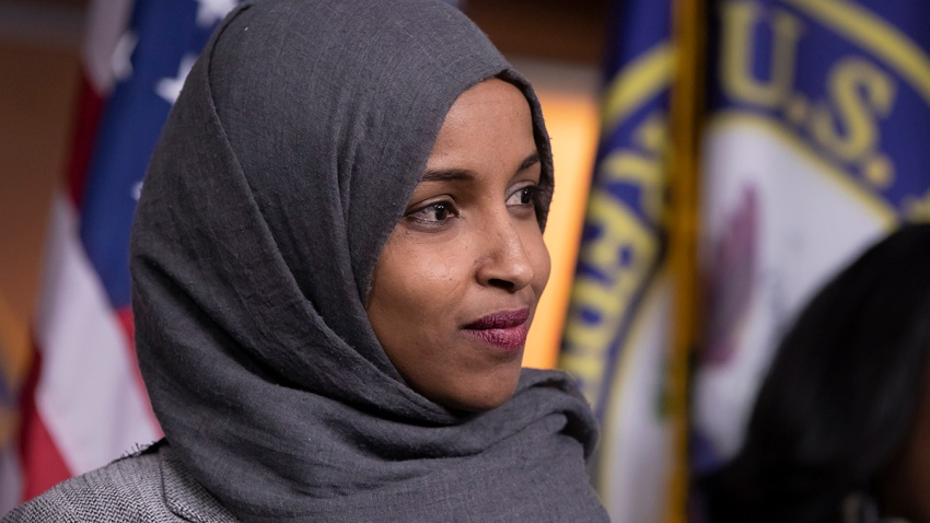 In this Nov. 30, 2018, file photo, Rep.-elect Ilhan Omar, D-Minn., joins House Democratic Leader Nancy Pelosi of California and newly-elected members at a news conference to discuss their priorities when they assume the majority in the 116th Congress in January at the Capitol in Washington.