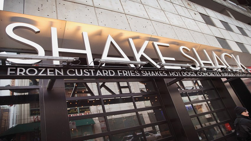 In this Jan. 28, 2015, file photo, a sign hangs outside of a Shake Shack restaurant in Chicago, Illinois.