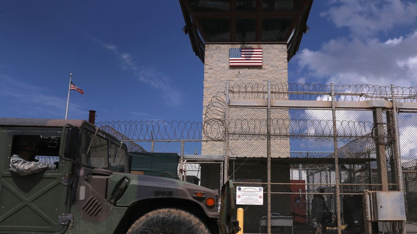 "A humvee passes the guard tower guard tower at the entrance of the U.S. prison at Guantanamo Bay, also known as ""Gitmo"" on October 23, 2016 at the U.S. Naval Station at Guantanamo Bay, Cuba."
