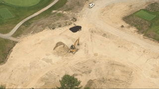 Construction at a Concord golf course where a worker fell into a trench