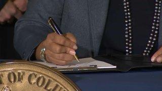 dc bill signing