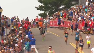falmouth road race 2019 runners thru crowds