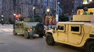 Massachusetts National Guard vehicles drive through Boston.