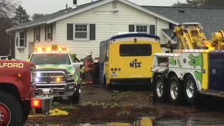 Emergency responders at the scene of a bus crash into a building in Milford, New Hampshire, on Thursday.