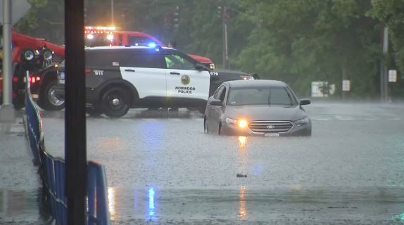 IMAGES: Cars Submerged in Norwood as Violent Storms Cause Flooding