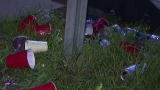 A file photo showing cups and cans on the ground.