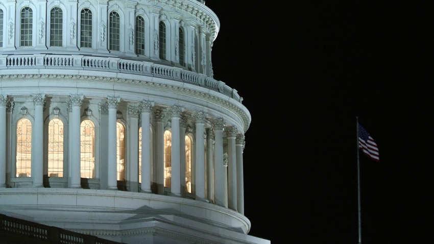 In this file photo, lights are on at the US Capitol as the House of Representatives works during a rare Sunday session on March 21, 2010 in Washington, DC.