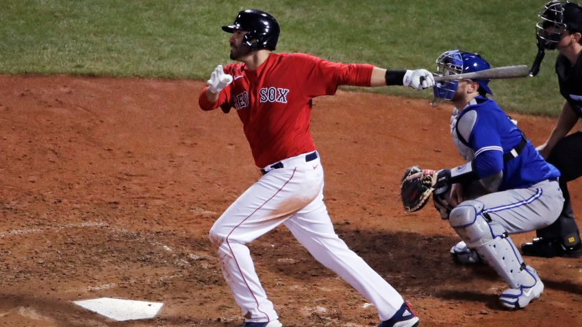 Boston Red Sox's J.D. Martinez watches the flight of his two-run home run during the fifth inning of an exhibition baseball game against the Toronto Blue Jays, Tuesday, July 21, 2020, at Fenway Park in Boston.