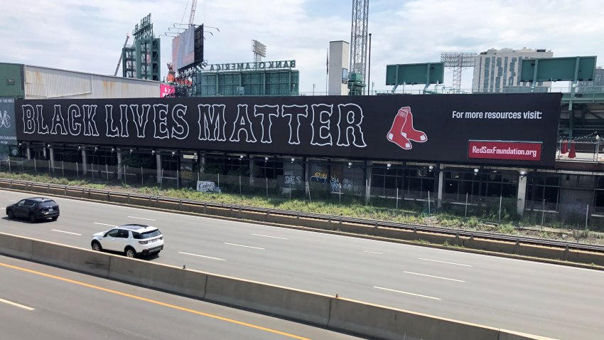 "A banner that reads ""Black Lives Matter"" is seen on the wall at Fenway Park facing the Massachusetts Turnpike"