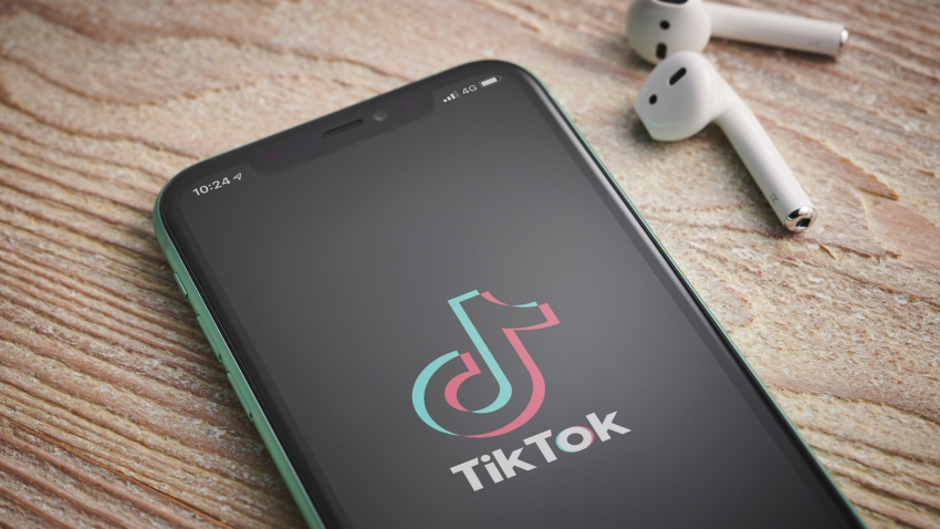An Apple iPhone 11 smartphone with the TikTok video sharing app logo