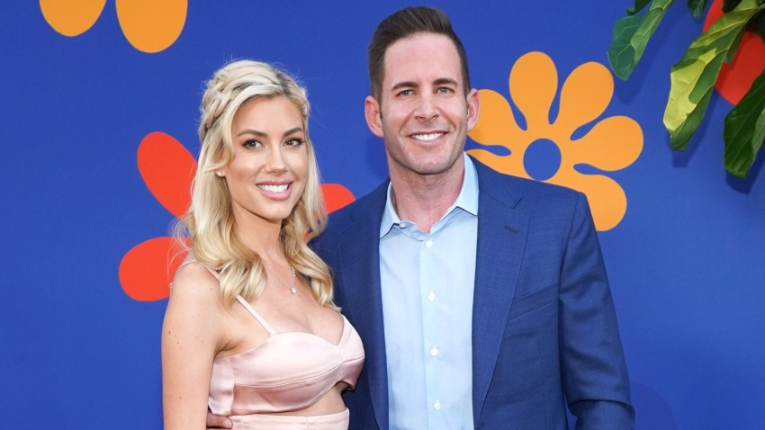 """In this Sept. 5, 2019, file photo, Tarek El Moussa and Heather Rae Young attend the premiere of HGTV's """"A Very Brady Renovation"""" at The Garland Hotel in North Hollywood, California."""