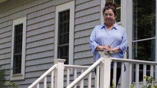 Poet Tammi Truax poses, Wednesday, July 29, 2020, on the front steps of her home in Eliot, Maine.