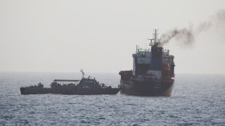 In this Wednesday, Aug. 12, 2020 photo released by the U.S. Navy, the MT Wila is boarded by Iranian navy commandos in the Gulf of Oman off the eastern coast of the United Arab Emirates. The Iranian navy boarded and briefly seized a Liberian-flagged oil tanker near the strategic Strait of Hormuz amid heightened tensions between Tehran and the U.S., a U.S. military official said Thursday, Aug. 13, 2020.