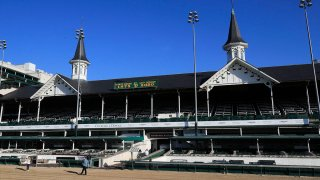 A view of the twin spires and empty grandstand at Churchill Downs, May 2, 2020, in Louisville, Ky.