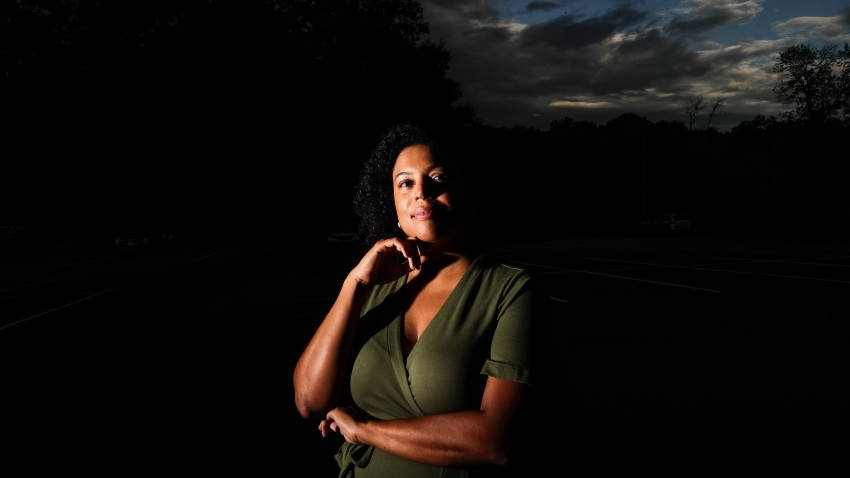 "In this July 24, 2020, file photo, Charisse Davis poses for a portrait in Marietta, Ga. Davis was recently elected the only Black woman on the Cobb County School Board. ""We've been watching from the sidelines and allowing other people to take their turns, and take these positions of power,"" Davis said. ""Now here we are to essentially fix it."""