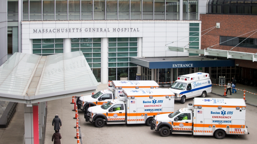Ambulances pull up to Massachusetts General Hospital in Boston on April 20, 2020.