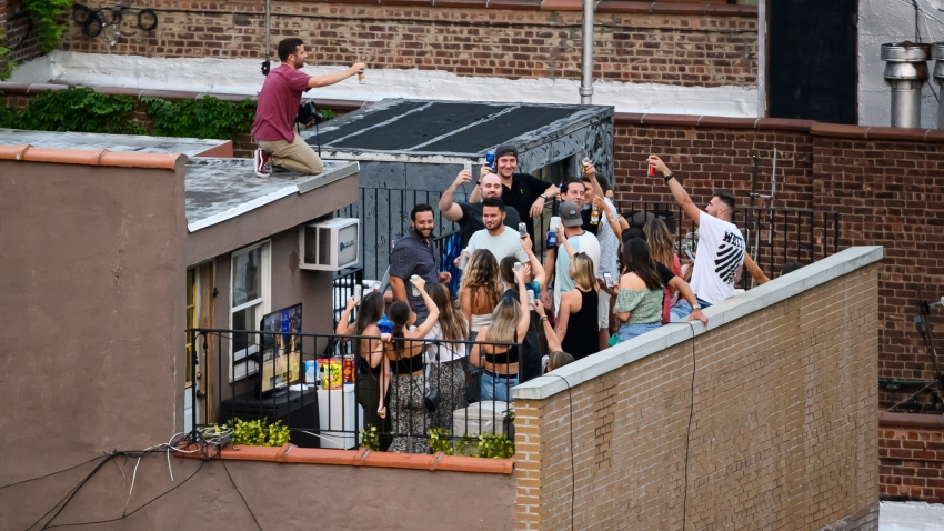 People party on a rooftop in Kips Bay, New York.