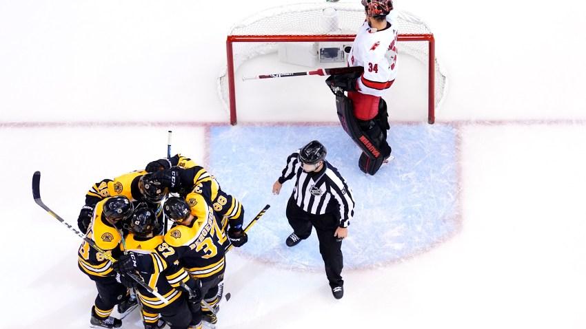 Bruins celebrate goal against Hurricanes