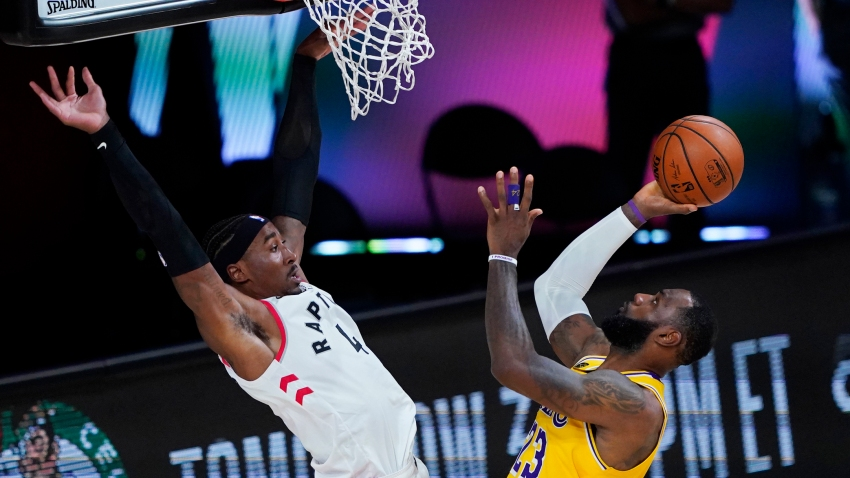 Los Angeles Lakers' LeBron James (23) shoots against Toronto Raptors' Rondae Hollis-Jefferson (4) during the second half of an NBA basketball game Saturday, Aug. 1, 2020, in Lake Buena Vista, Fla.