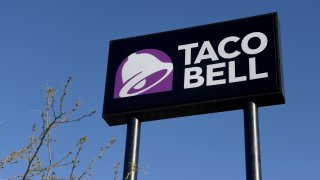 In this March 30, 2020, file photo, an exterior view shows a sign at a Taco Bell restaurant in Las Vegas, Nevada.