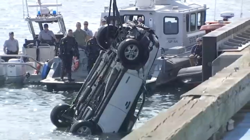 A white Ford Escape is pulled from Boston's Reserved Channel