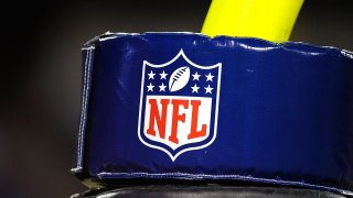 FILE - The NFL shield and doughnut around the goal post, Aug. 9, 2008, in Nashville, Tennessee.