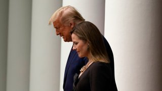 President Donald Trump walks with Judge Amy Coney Barrett to a news conference to announce Barrett as his nominee to the Supreme Court, in the Rose Garden at the White House, Saturday, Sept. 26, 2020, in Washington.