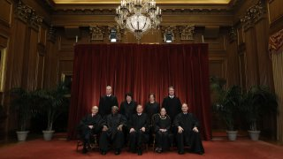 This Nov. 30, 2018, photo, shows United States Supreme Court (Front L-R) Associate Justice Stephen Breyer, Associate Justice Clarence Thomas, Chief Justice John Roberts, Associate Justice Ruth Bader Ginsburg, Associate Justice Samuel Alito, Jr., (Back L-R) Associate Justice Neil Gorsuch, Associate Justice Sonia Sotomayor, Associate Justice Elena Kagan and Associate Justice Brett Kavanaugh as they pose for their official portrait in the East Conference Room at the Supreme Court building