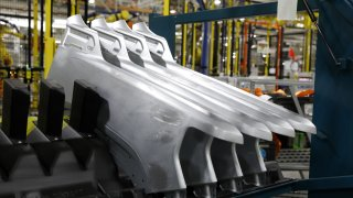 Pickup truck side panels sit on the assembly line at the General Motors Co. plant in Flint, Michigan, U.S., on Tuesday, Feb. 5, 2019.