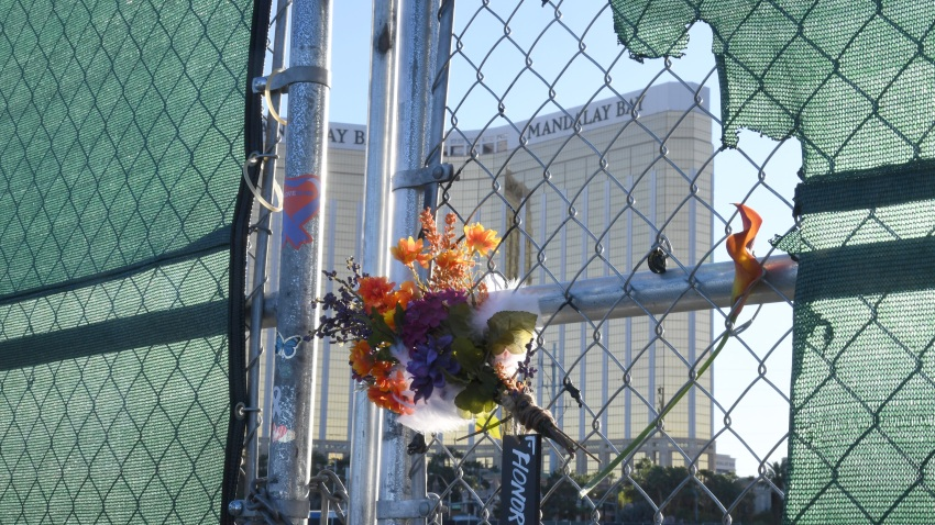"Flowers and a sign reading ""HONOR 58"" hang on a fence outside the Las Vegas Village across from Mandalay Bay Resort and Casino as a tribute to those killed almost two years ago in a massacre at the site on September 30, 2019 in Las Vegas, Nevada. On October 1, 2017, a gunman opened fire from the 32nd floor of Mandalay Bay on the Route 91 Harvest country music festival in Las Vegas killing 58 people and injuring more than 800 in the deadliest mass shooting event in U.S. history."