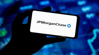 POLAND - 2020/03/19: In this photo illustration a JP Morgan Chase logo seen displayed on a smartphone.