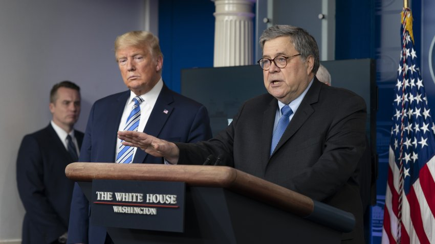 """Attorney General William Barr, right, speaks as U.S. President Donald Trump listens during a Coronavirus Task Force news conference in the briefing room of the White House in Washington, D.C., U.S., on Monday, March 23, 2020. Trump said the U.S. economy cant remain slowed for too long to fight coronavirus, declaring the country """"was not built to be shut down."""""""