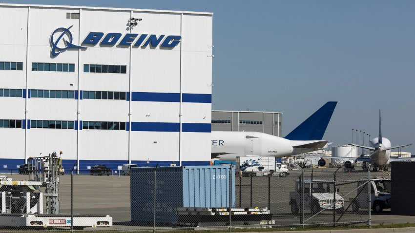 Boeing manufacturing facility with airplane behind it