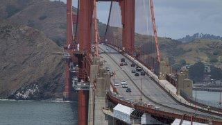 Traffic travels over the Golden Gate Bridge in San Francisco, California