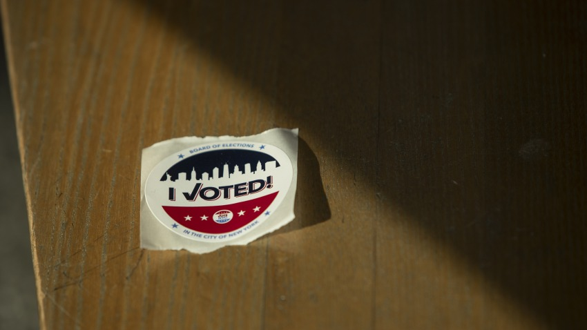 "An ""I Voted"" sticker sits on a bench at a polling location in Brooklyn borough of New York, U.S., on Tuesday, June 23, 2020."