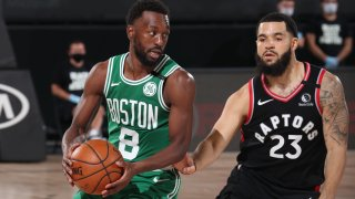 The Boston Celtics' Kemba Walker holds the ball in a playoff game against the Toronto Raptors