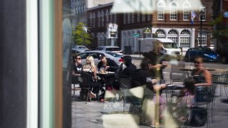 Customers dining outside of a restaurant in Concord, NH