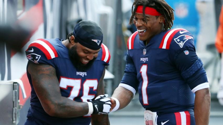 New England Patriots Cam Newton and Isaiah Wynn talk before the 2020 season opener