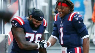 New England Patriots Cam Newton and Isaiah Wynn talk before the 2020 season opener