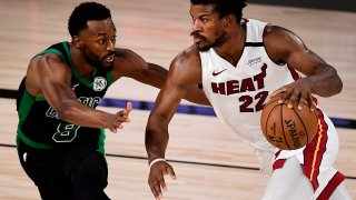 Jimmy Butler #22 of the Miami Heat drives the ball against Kemba Walker #8 of the Boston Celtics during the fourth quarter in Game One of the Eastern Conference Finals during the 2020 NBA Playoffs at The Field House at the ESPN Wide World Of Sports Complex on September 15, 2020 in Lake Buena Vista, Florida.
