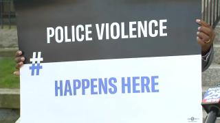 Police Violence Happens Here Sign
