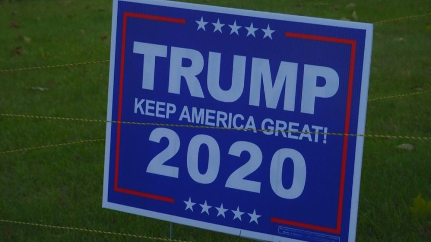 A Trump 2020 sign surrounded by electrified wire in a New Bedford, Massachusetts, yard.