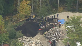 A rescue operation after an excavator rolled over in Sutton, Massachusetts