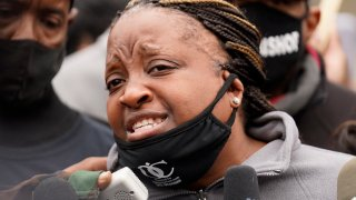 Tafara Williams's mother Clifftina Johnson speaks during a protest rally for Marcellis Stinnette