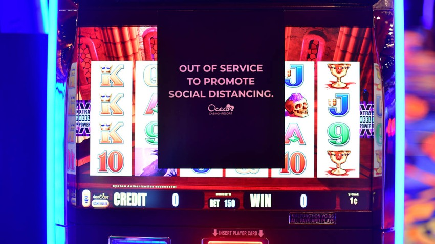 A sign on a slot machine promotes social distancing at Ocean Casino, July 3, 2020, in Atlantic City, New Jersey.