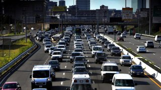 In this Aug. 6, 2020, file photo, Boston traffic at evening rush hour.