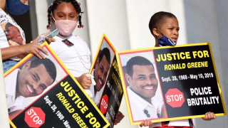 """Family members of Ronald Greene listen to speakers during the """"Commitment March: Get Your Knee Off Our Necks"""" protest against racism and police brutality, at the Lincoln Memorial on August 28, 2020, in Washington DC. Greene died in police custody following a high-speed chase in Louisiana in 2019."""